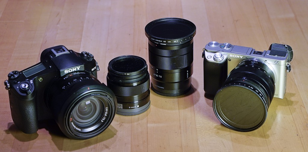 My travel kit for Bali (left to right) a Sony RX10 with its built-in equivalent 24-200mm f/2.8 Zeiss, a 35mm f1.8 Sony prime, a Zeiss 16-70mm f/4 E, and a Sony A6000 mounted with a Sony 10-18mm ultrawide zoom.